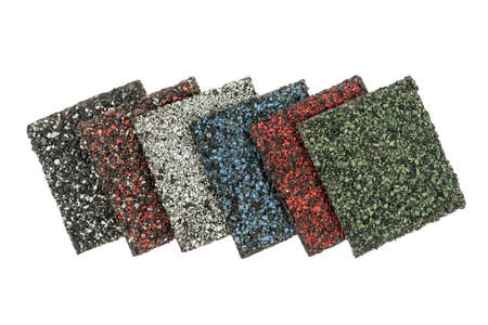 Roofing material asphalt shingles samples of various colors isolated on white background