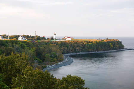 Scenic view of Cap-de-la-Madeleine historic site with lighthouse on Gaspe peninsula in Quebec, Canada.