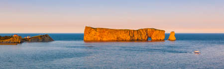 Perce Rock panoramic view from  Gaspe Peninsula at sunset  in Quebec, Canada Фото со стока
