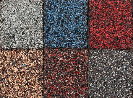 Roofing material asphalt shingles samples of various colors, closeup