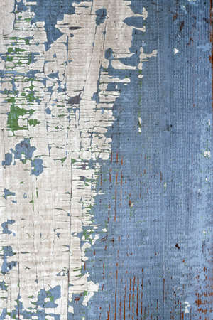 Background of old distressed wood board with peeling paint Фото со стока
