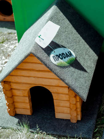 Beautiful new doghouse made of wood with the inscription on the roof