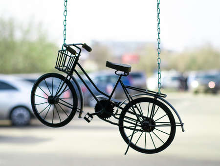 Bicycle-suspension on chain. Symbol of healthy lifestyle.
