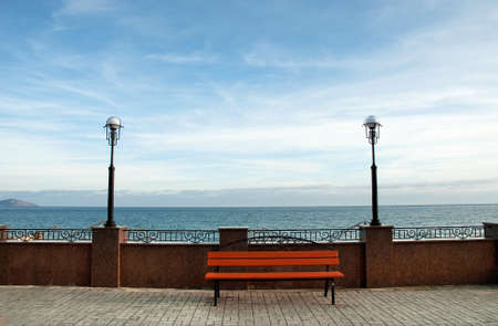 Wooden bench in front of the sea  photo