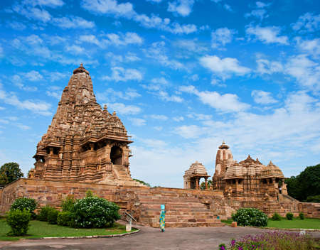 Kandariya Mahadeva Temple, dedicated to Shiva, Western Temples of Khajuraho under cloudy sky, Madya Pradesh, India.      photo
