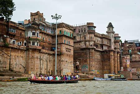 varanasi: VARANASI, INDIA - OCT 1: Hindu people in a boat near Ghat on the banks of Ganges river in holy city of Varanasi, October 1, 2013 in Varanasi, India. Editorial