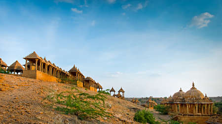 jainism: The royal cenotaphs of historic rulers, also known as Jaisalmer Chhatris, at Bada Bagh in Jaisalmer made of yellow sandstone at sunset