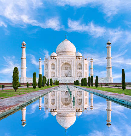 Amazing view on the Taj Mahal in sun light with reflection in water. The Taj Mahal is an ivory-white marble mausoleum on the south bank of the Yamuna river. Agra, Uttar Pradesh, India. Editorial