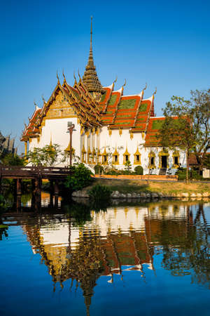 Amazing view of beautiful Dusit Maha Prasat Palace (The Grand Palace) with reflection in the water. Location: Ancient City Park, Muang Boran, Samut Prakan province,  Bangkok, Thailand. Artistic picture. Beauty world.