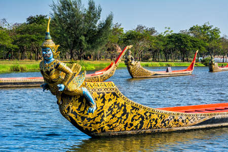 Ancient Siam park, Royal Water-Course Procession, decorated wooden thai boats on pond closeup. Location: Ancient City, Mueang Boran, Samut Prakan Province, Bangkok, Thailand.