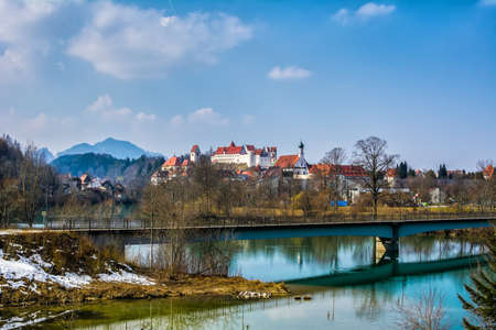 Old buildings of Fussen city. St. Mang Basilica, High Castle. Fussen, Germany Stock Photo