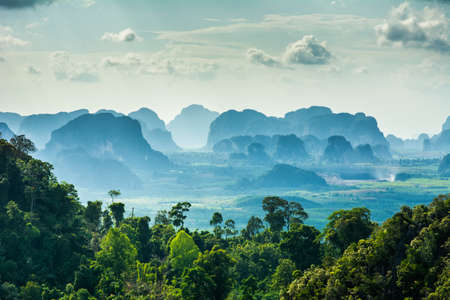 Amazing view from Wat Tham Seua (Tiger Cave Temple), Krabi province, Thailand. Beautiful silhouettes of mountains