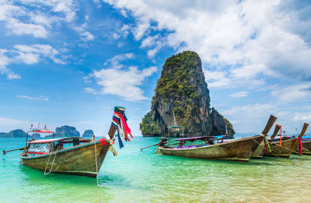 Amazing view of beautiful beach with longtale boats. Location: Railay beach, Krabi, Thailand, Andaman Sea. Artistic picture. Beauty world. Stock Photo
