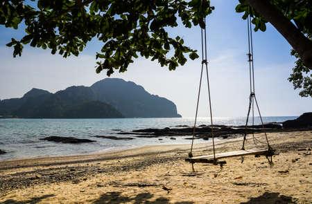 Swing hang from tree over beach, Island Koh Phi Phi Don, Krabi, South Thailand.