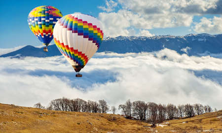 Colorful hot-air balloons flying over the mountain.Artistic picture. Beauty world.