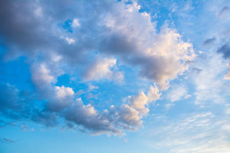 Beautiful blue sky with clouds in the shape of heart. Abstract background