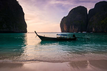 Traditional thai longtale boat at Maya bay in Phi Phi Island. Location: Krabi Province, Thailand, Andaman Sea. Artistic picture. Beauty world.