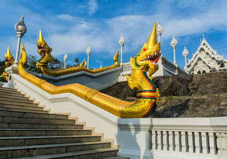 The staircase of the central entrance in Buddha Temple Kaeo Ko Wararam with dragons. Location: Krabi, Thailand. Artistic picture. Beauty world.