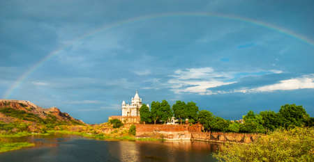 Amazing view on Jaswanth Thada mausoleum after the rain with a rainbow in the sky. Location: Jodhpur, Rajasthan, India. Artistic picture. Beauty world.