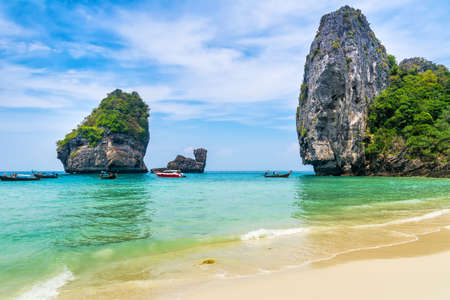 Amazing view of beautiful beach on Phi Phi Island with longtale boat. Location: Krabi Province, Thailand, Andaman Sea. Artistic picture. Beauty world.