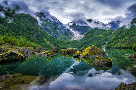 Amazing lake on a background of mountains and glacier. Norway. Beautiful landscape. Artistic picture. Beauty world.