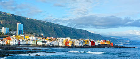View of colourful houses of Punta Brava from beach Jardin in Puerto de la Cruz, Tenerife, Canary Islands, Spain