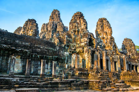 Beautiful Bayon temple in Angkor Thom on the sunset. Ancient Khmer architecture. Location: Siem reap, Cambodia. Фото со стока