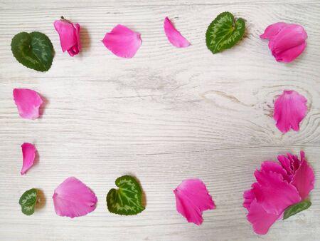 flower petals on wooden background composition