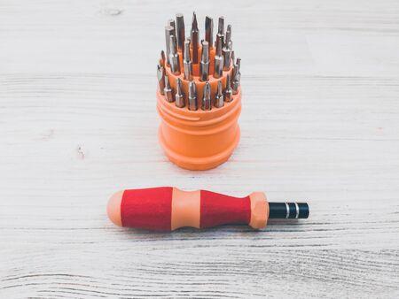 screwdriver screwson wooden background