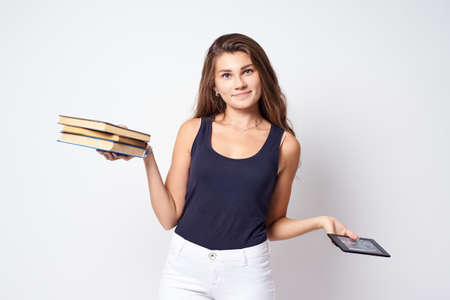 Choice books for training. Young student. Portrait girl. Stock Photo