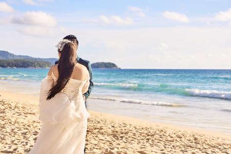 Bride and groom. Relax on beach. Wedding.
