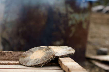 Wooden disk. Round log house. Blurred Background. Stock Photo