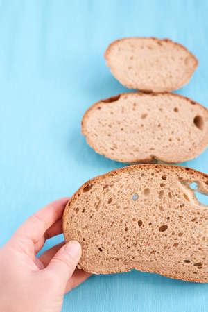 Three slices bread. Unusual tree. Blue background.