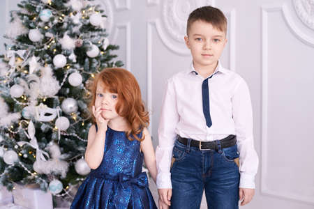 Brother and sister. Family portrait. Christmas interior. Small children. Stock Photo