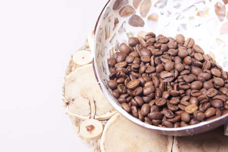 White light background. Coffee beans in a cup. Stock Photo