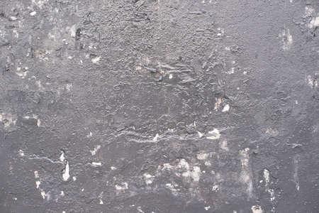 Dark gray uneven covering. Inaccurate brush strokes.