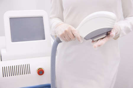 Modern equipment. Personal care. Laser hair removal. Light background.