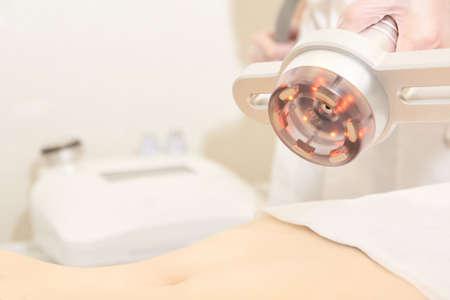 Body cavitation treatment. Ultrasound care to fat reduction. Beauty ultrasonic massage therapy at salon. Anti cellulite.