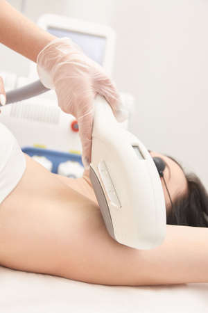 Medical beauty laser cosmeology procedure. Young female at salon. Professional doctor. Woman skincare technology. Hair removal.