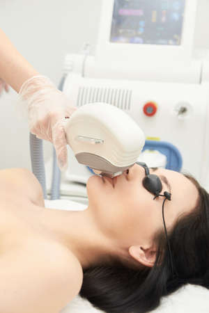 Hair laser removal service. IPL cosmetology device. Professional apparatus. Woman soft skin care.mustache