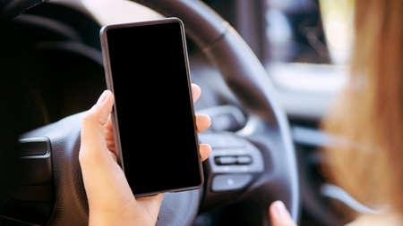 Phone in car. Mockup screen app. Travel map.