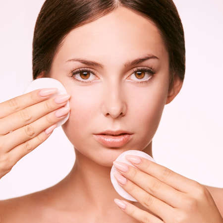 Cleansing face wasing tonic. Demakeup. remove mascara. Cotton pad hand. Stock Photo