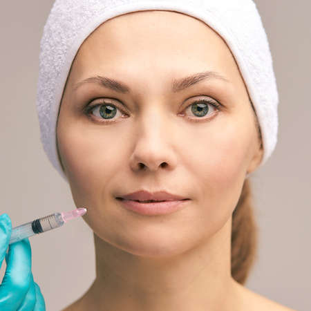 Facial injecting treatment. Skin platelet. Prp rich plasma injection. Beauty woman. Doctor gloves.
