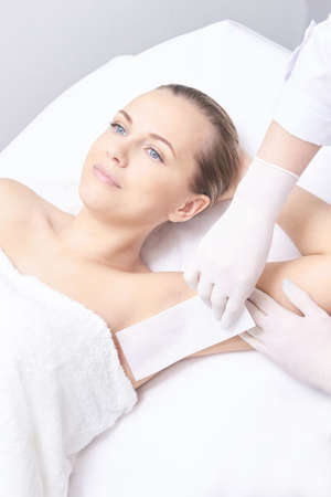 Waxing woman leg. Sugar hair removal. laser service epilation. Salon wax beautician procedure. Stock fotó