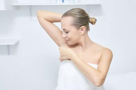 Waxing woman body. Sugar hair removal. laser service epilation. Salon wax beautician procedure.