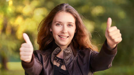 Young girl with gesture thumb up. Success businesswoman. Stok Fotoğraf