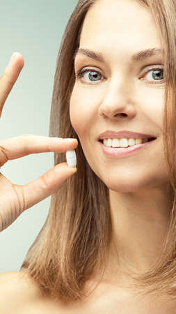 Girl take white pill. Human drink painkiller. Anti headache supplement. Mature woman. Banco de Imagens