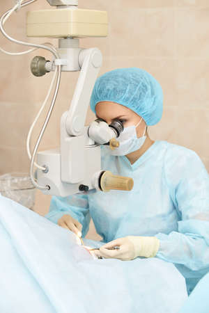 Ophthalmology laser microscope operation. Doctor in clinic. Patient eye treatment. Myopia and cataract removal.