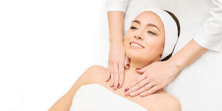 Facial salon massage. Woman professional therapy. Hands at neck. Healthy cosmetic procedure. Luxury spa treatment.