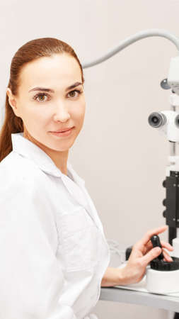 Eye ophthalmologist exam. Eyesight recovery. Astigmatism check concept. Ophthalmology diagmostic device. Beauty girl portrait in clinic. Stok Fotoğraf